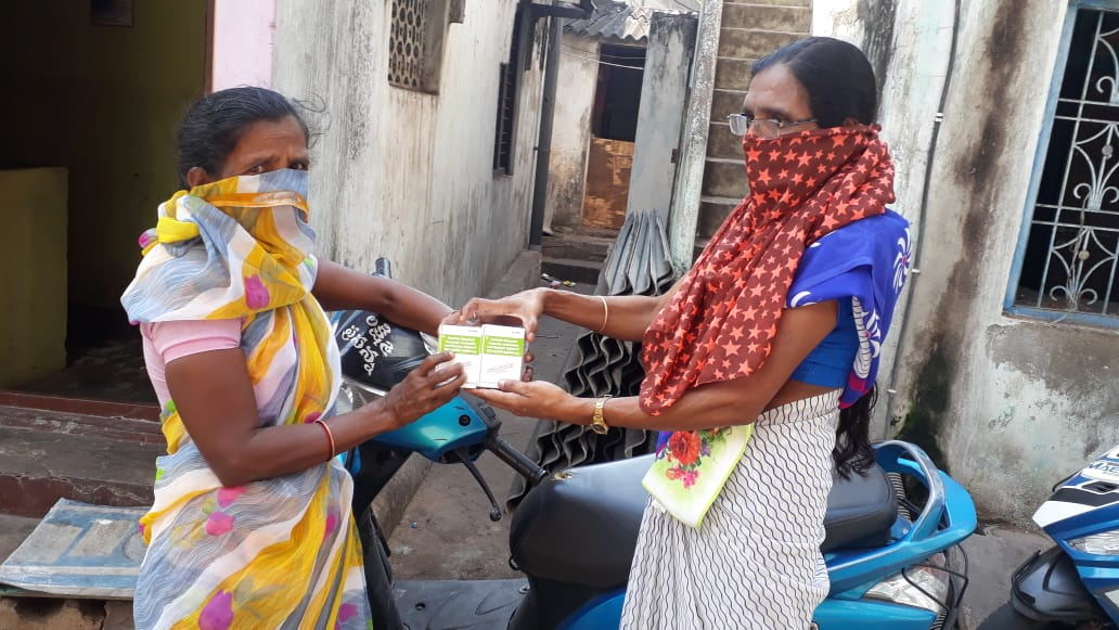 A woman receives her ARV medications provided to her at the doorstep by one of our frontline workers in Pali, Rajasthan.