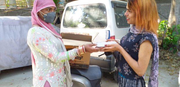 Food distribution among transgender and hijra community at Mayur Vihar, Delhi.