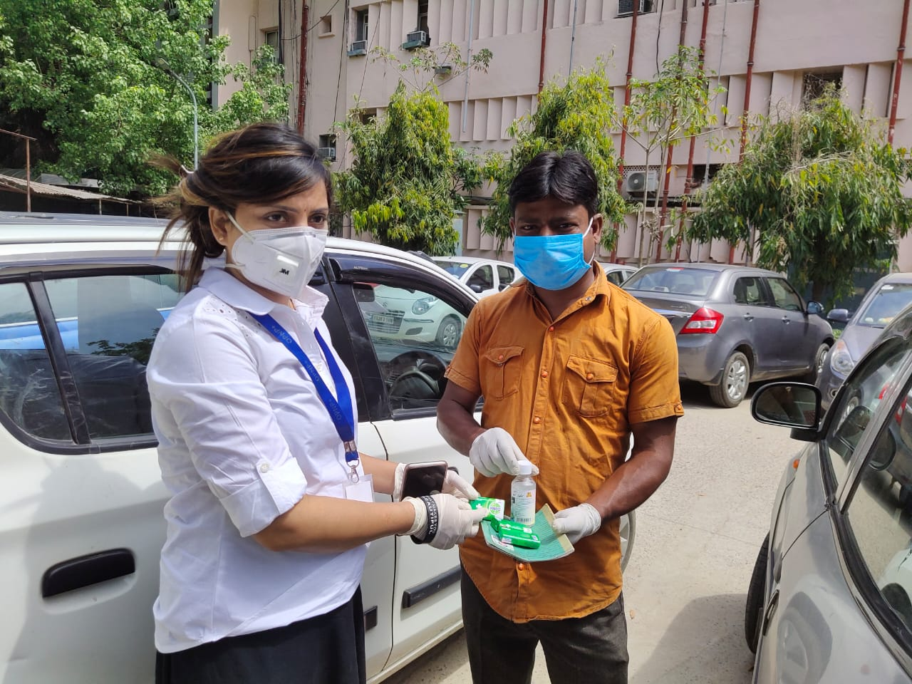 One of our outreach workers distributing hygiene product
